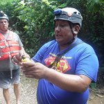 Charlie Chan explaining the Cashew plant to us in the forest