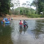 Crossing the river for cave tubing
