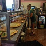 Pizza lady who makes serving a fun spectator sport