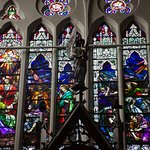 One row of many jewel-toned stained glass windows