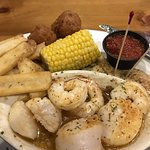 Seafood platter: scallops, shrimp, grouper, french fries, hush puppies, and corn on cob