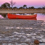 again the iconic canoe in the sunset on Lake Magic