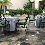 Outdoor tables beautifully set up next to the pool area.