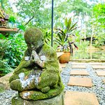 One of the Spirit Houses, and Buddhas that fill the gardens