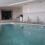 Indoor pool with the steam room at the back