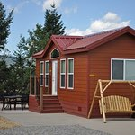 Deluxe Cabin, sleeps 6. Includes linens, a/c, fire-pit, fridge, full bath, t.v., grill, & much m