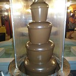 Milk chocolate fountain in hotel courtyard
