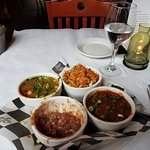 Sampler with Jambaylaya, shrimp creole, red beans and rice, and crawfish etouffe.