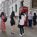 Tour group being told what phone booths are really used for nowadays...