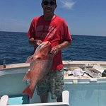 Gary caught a red snapper, unfortunately it had to be thrown back