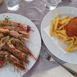 Grilled seafood; breaded pork on french fries