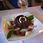 Delicious chocolate ball sundae - melts away to reveal ice cream inside after waiter pours hot c