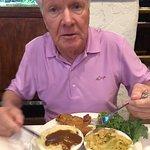 Peter eating smothered pork chops