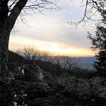 A view outside the Skyland Restaurant shows the sun setting over the valley.