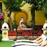Buddha and sunloungers in the stunning grounds of Kathmandu Guest House in Thamel