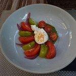 Burrata cheese w/ pesto and tomatoes
