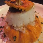 Pumpkin stuffed with risotto and a scallop