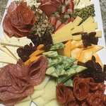 Freshly catered Cheese and Charcuterie Platters just give us a call we do it all!
