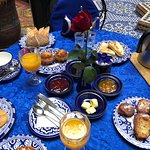 delicious breakfast with a blue tablecloth that day