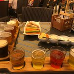 Beer and cider tasting paddle with course one of the food