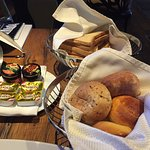 Bread basket, assortment of jams and butter