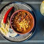 BEEF SOUP. Spicy soup with beef, tomatoes and olives