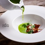 Cold green pea soup with goat cheese and bacon crumb
