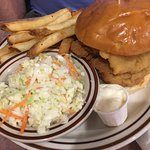 fried oyster sandwich with cole slaw and fries