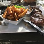 Tender sirloin steak - rare, as requested - with hand-cut chips, mushrooms, rocket and pepper sa