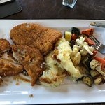 Veal cutlets with inedible vegetables