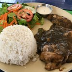 Jerk chicken, rice and salad