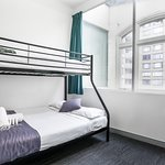 Triple double room with shared facilities.