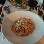 Penne Gigi, a very good rosé sauce with small pieces of chicken mixed in, and some green onions.