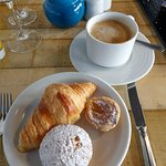 Breakfast coffee and pastries.
