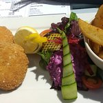 Smoked haddock and chive fishcakes, salad, home made purple coleslaw, chips