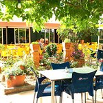 Seating available in a pretty, shady garden for breakfast & lunch.