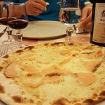 Salmon pizza, and a bottle of red house wine
