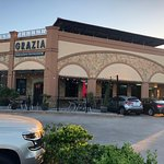 Grazia Italian Kitchen Pearland exterior - note roof solar panels and available outdoor seating