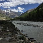 River, green and snow clad mountains!