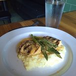 Grilled chicken & asparagus with beer cheese and country ham dust over grits