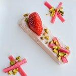 Strawberry Rhubarb Panna Cotta - Poached rhubarb, pistachio crumble