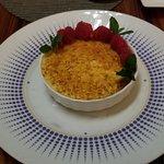 Vanilla creme brulee with raspberries