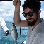 Catching a Jack Fish on a Fishing Tour with CocoVibes Tours