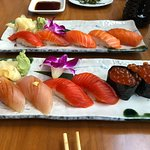 Salmon sampler in back. White tuna, salmon & ikura in front