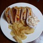 Slow roast chicken, cheese & tomato toastie w coleslaw & crisps.