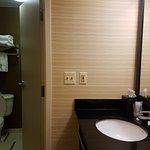 Bathroom w/ outside sink vanity in double queen room on the 2nd floor