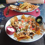 Angry Nachos (front), chicken quesadillas + crispy ground beef taco (back)