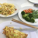 Vietnamese pancake, fried rice with vegetables, fresh steamed broccoli, greenbeans and carrots
