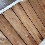 Shabby shower tray leaks over bathroom floor