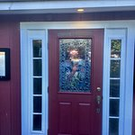 Entrance with pheasant stained glass